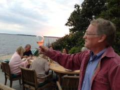 Russ McCall holds sunset in a glass at the McCall 10-Mile Dinner 2013